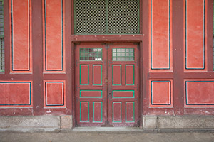 A large set of doors on the grounds of Deoksu Palace in Seoul, South Korea.