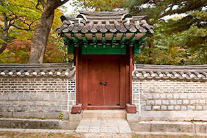 Door and gateway leading into one of the many courtyards at Changdeok Palace in Seoul, South Korea.